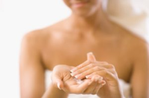 Isotretinoin Side Effect: Apply a moisturiser to the face and body after showering daily.